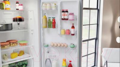 Холодильник с морозильником Hotpoint-Ariston HTS 4200 M